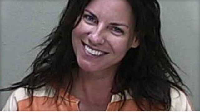 FL woman smiles in mugshot after deadly DUI crash, police say