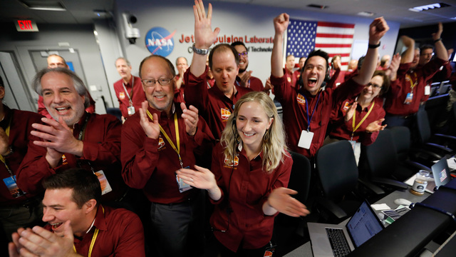 NASA spacecraft lands on red planet after six-month journey